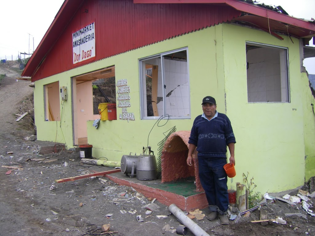 Dago in front of his destroyed store (September 2010)