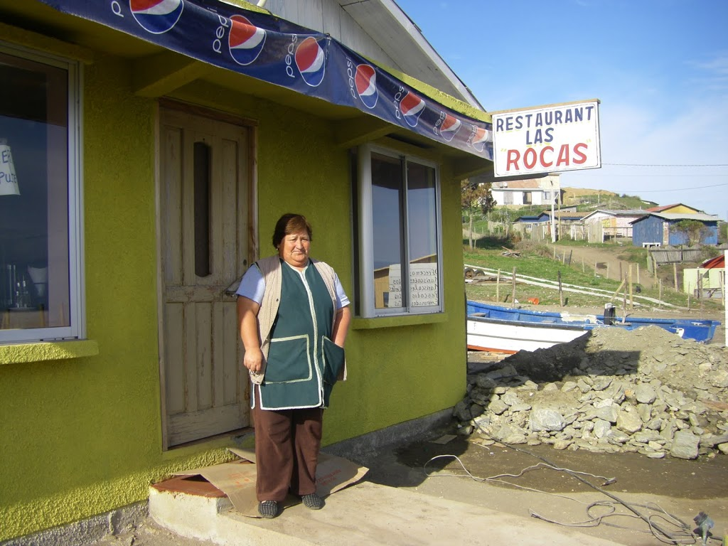 "Maria, in front of her temporary restaurant ""Las Rocas"" (October 2010)"