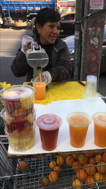 Luz preparing fresh orange juice along Eliodoro Yañez Street