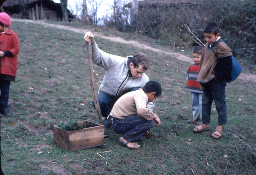"""Doug showing future tree planters how to do it: """"Roots down!"""""""