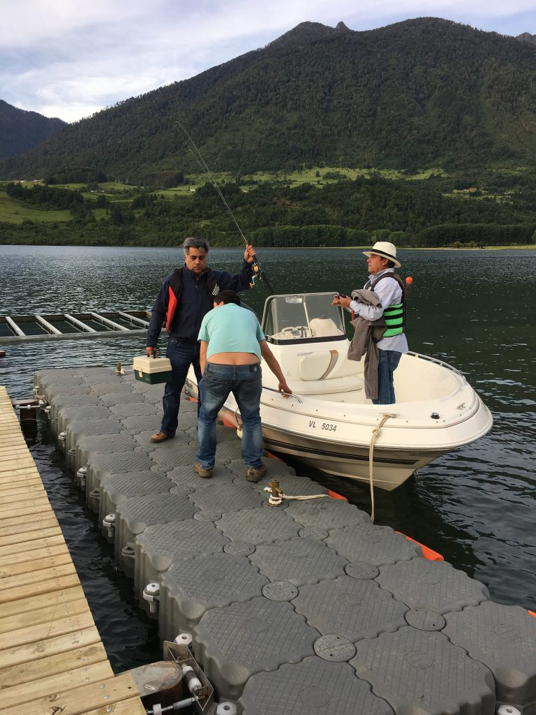 Cristian helping Pablo and Francisco get off on a fishing excursion on Lago Ranco